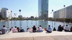 People have rest sitting around Bassin de Takis Stock Footage