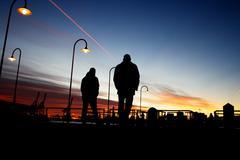 Italy, Liguria, Genoa, People walking along docks of Genoa harbor Stock Photos
