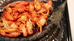 Red boiled crayfishes and sturgeons baked in oven on tray. Stock Footage