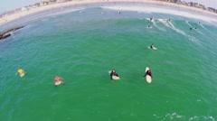 Many surfers get fun in water in Breakwater surfing break Stock Footage