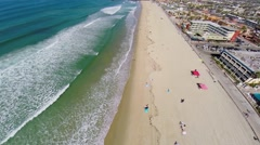 Wavy water of pacific ocean and Pacific Beach in San Diego - stock footage