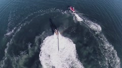 Man flies on waterjet near waterbikes with people in Sail Bay Stock Footage