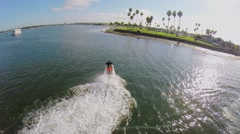 Man flies on waterjet in Sail Bay near San Diego at sunny day. Stock Footage