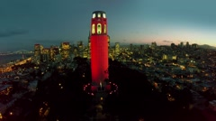 Coit Tower against cityscape with illumination at evening. Stock Footage