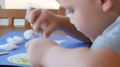 Stock Video Footage of Cute little boy making and coloring a helicopter on paper