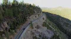 Transport drive by California State Route 120 along mountains Stock Footage