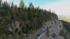 California State Route 120 with cars ride along mountains Stock Footage