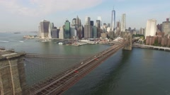 Backward Aerial real time video of Brooklyn Bridge and Downtown, New York. 4K - stock footage