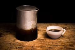Freshly brewed coffee and moka pot Stock Photos