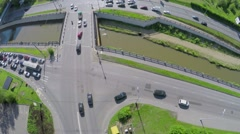 Cars ride by embankment and bridge over Jauza river Stock Footage