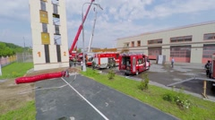 Firemen walk near special transport in fire station at spring Stock Footage