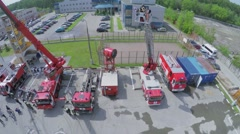 Journalists work on fire-station at spring sunny day. Aerial view Stock Footage