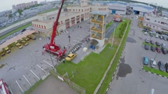 Fire station with fire-crane which lifts car at spring sunny day Stock Footage