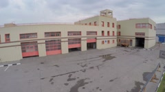 Fire station garage with special transport. Aerial view Stock Footage