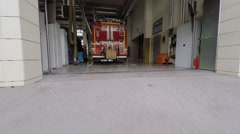 Fire engine is in garage of fire station. Aerial view Stock Footage