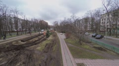 Cars ride by boulevard at spring cloudy day. Aerial view Stock Footage
