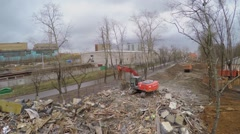 Excavator puts ash in truck at spring cloudy day. Stock Footage