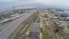 Cityscape with railway at spring cloudy day. Aerial view Stock Footage