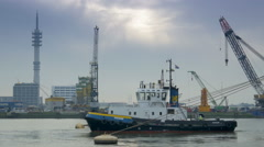 Tow boat at work at the harbor of Rotterdam Stock Footage