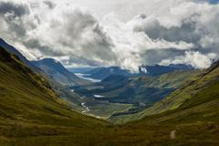 Scotland, Glen Etive, View of cloudy sky above valley Stock Photos
