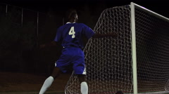 A soccer team celebrates after making a goal - stock footage