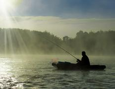 In the morning mist on fishing Stock Photos