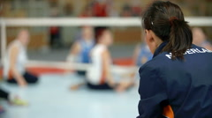 One volleyball player is sitting on the bench Stock Footage