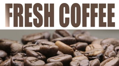 Fresh coffee title over video Stock Footage