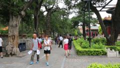 Visitors to the historic Jingshan Park in Beijing Stock Footage