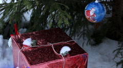 Gift under Christmas tree on the snow. Close-up - stock footage