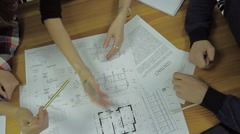 Group of Architects Planning on a New Project with their Blueprint - stock footage