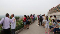 Tourists on a viewing platform in the Jingshan park, Beijing Stock Footage
