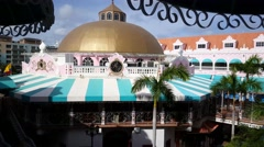 Walking in the colorful Royal Plaza Mall in Oranjestad Aruba Stock Footage