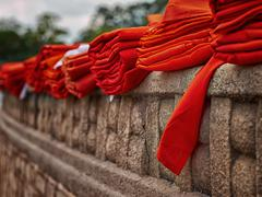 Sri Lanka, Anuradhapura, Red monks robes on fortified wall Stock Photos