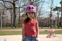 Disappointed child (4-5) in bike helmet Stock Photos