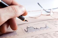 Business man and statistics detail Stock Photos
