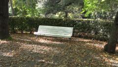 Retro white wooden bench in autumn park Stock Footage