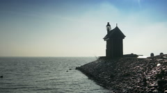 Beacon at the Ijsselmeer. Volendam, The Netherlands Stock Footage