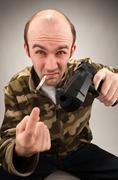 Impudent bandit with gun Stock Photos
