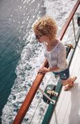 Greece, Santorini, Elevated view of young woman on ship - stock photo
