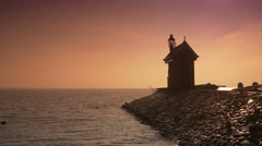 Beacon at the Ijsselmeer at sunset. Volendam, The Netherlands Stock Footage