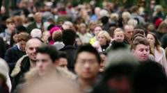Crowd of people on busy shopping street slo mo Stock Footage