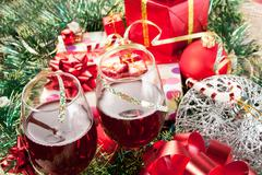 Holiday gifts and wine glasses - stock photo