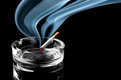 Cigarette on ashtray - stock photo