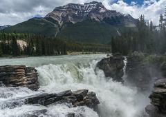 Canada, Alberta, Jasper National Park, View of Athabasca Falls and Mt Kerkeslin - stock photo