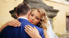 Stock Video Footage of Happy and cheerful wedding couple showing tender feelings to each other. shot in