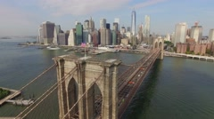 Aerial shot of Brooklyn Bridge. Camera moving slowly towards Manhattan. Stock Footage