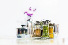 Powder spices in glass bottle jar Stock Photos