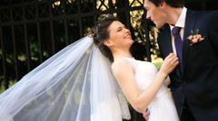 Young luxury gorgeous happy bride and groom on the background of sunny city Stock Footage