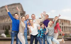 Stock Photo of group of happy people having fun over coliseum